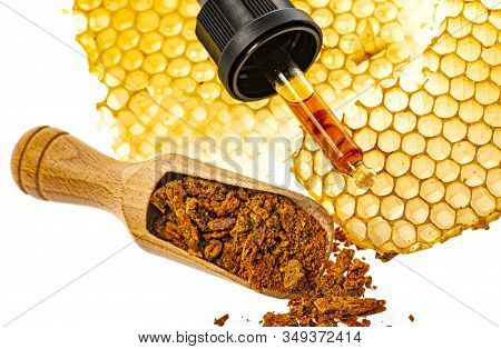 Propolis Tincture And A Wooden Spoon Of Propolis Granules