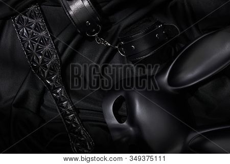 Top View Of Sex Toys On Black Textile Background
