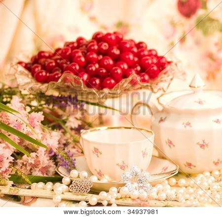 Vintage tea in elegant tableware with flowers