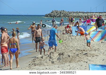 Wladyslawowo / Poland. 24 June 2019:  People Relax On Beach Of Baltic Sea During Summer Vacation. Ba
