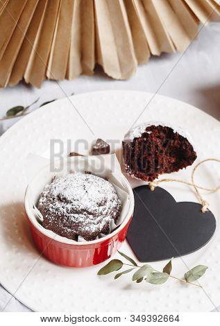 Chocolate Muffin In Red Cup. Mockup Valentine Black Heart Copyspace. Small Glazed Ceramic Ramekin Wi
