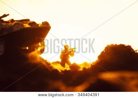 Battle Scene With Toy Soldier Near Tank On Battleground On Yellow Background