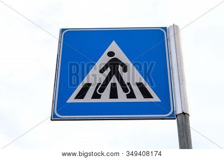 An Indicator Sign Showing That Pedestrians Are Crossing