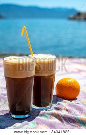 Two Glasses With Greek Cold Iced Instant Coffee With Foam Frappe On Sunny Beach