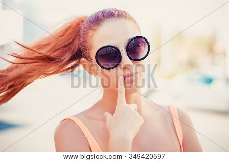 Daydream. Happy Woman Looking Up Thinking Daydreaming Hand On Cheek, Lips On Street Background With