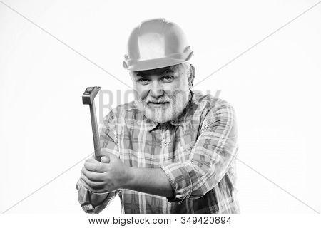 Repair Workshop. Repair Concept. Senior Foreman Worker. Home Improvement Repair. Man Bearded Laborer