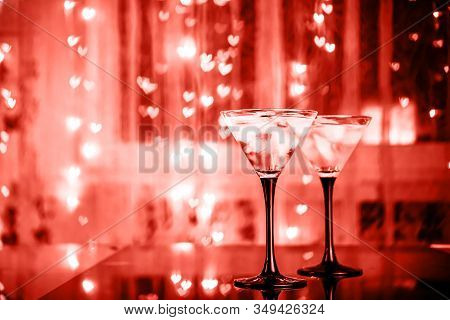 Couple Of Cocktail Glasses With Martini Drink With Ice On Trendy Black Background With Bokeh Lights.