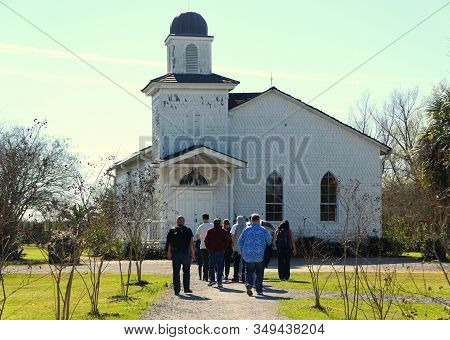 Edgard, Louisiana, U.s.a - February 2, 2020 - Visitors In Front Of The White Church Near Whitney Pla