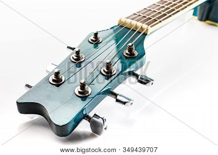 Headstock Of Classic Acoustic Guitar With Tuning Keys, On A White Background.