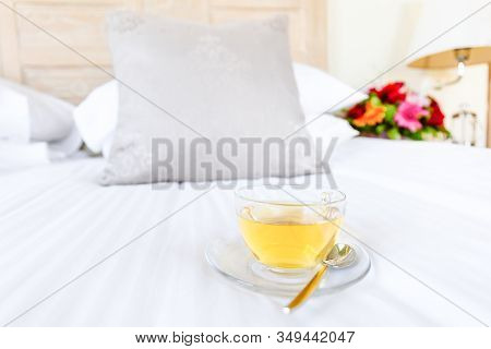 Herbal Tea On Bed Linen In The Upscale Hotel Room. Being Alone, Getaway, Staycation, Digital Detox C