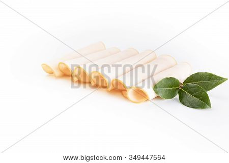 Poultry Cold Cuts Cut Into Slices, Rolled, Isolated On White Background, Top View.