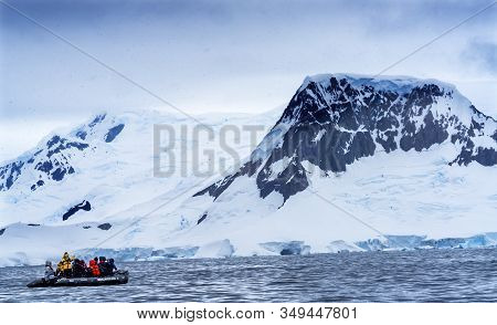 Charlotte Bay, Antarctica - December 26, 2019 Ship Tourists Rubber Boats Zodiac Glaciers Snow Mounta