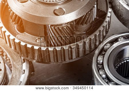 Set Of Various Engine And Gearbox Spare Parts. Shiny Gears For Planetary Gearbox.metal  Autotechnolo