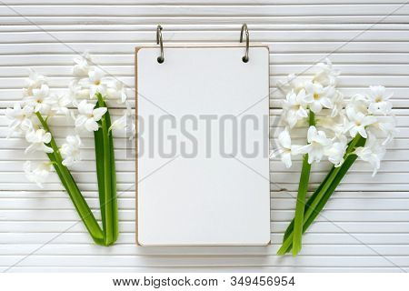 Spring Flat Lay.spring To-do List.white Blank Notebook, Cup Of Tea And Spring Flowers White Hyacinth