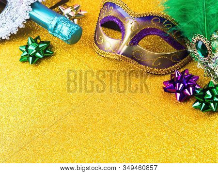 Colorful Mardi Gras Carnival Masks And Green Champagne Bottle On Golden Glitter Background. Festive