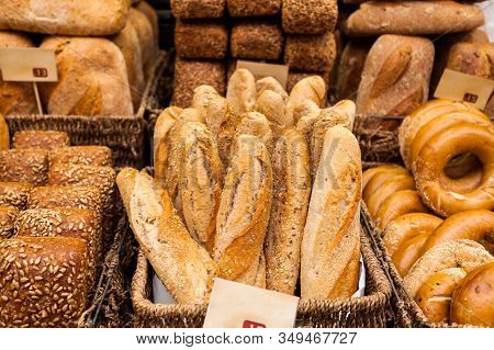 Baskets With Different Types Of Bread On A Display Case At Mahan Yehuda Market In Jerusalem, Israel.