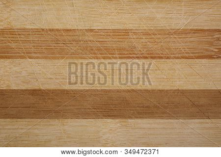 Used Kitchen Cutting Bamboo Board Background. Wooden Background.
