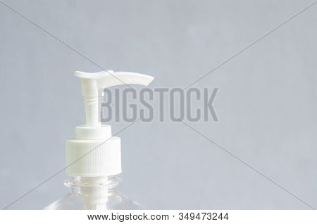 White Bottle Alcohol Gel Hand Scrub On Grey Background.