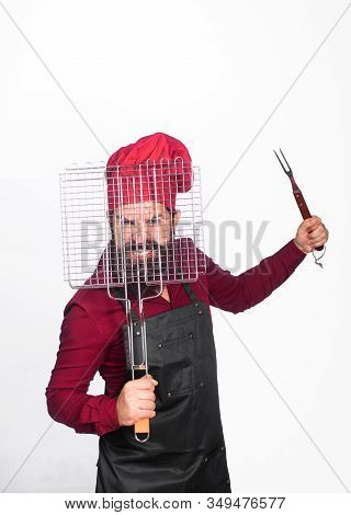 Chief Cook In Workwear With Utensils For Barbecue Grill. Cooking. Grill Cook With Barbecue Grid. Che