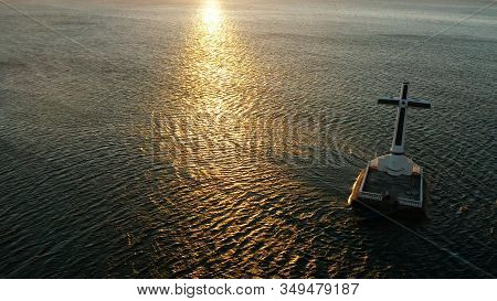 Catholic Cross In Sunken Cemetery In The Sea At Sunset, Aerial View. Sunset At Sunken Cemetery Camig
