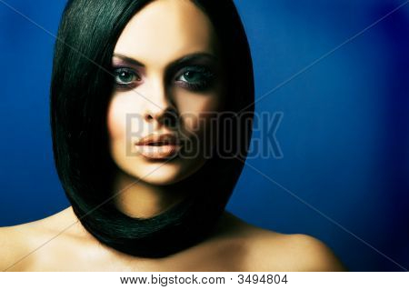 Brunette Girl Posing On Dark Background