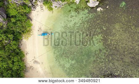 Rocky Island With A Small White Beach, View From Above. Kagbalinad Islands, Philippines. Tropical Is