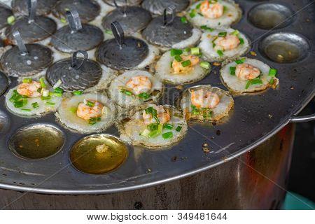 Sizzling Vietnamese Tiny Shrimp Pancake On Skillet- Banh Khot
