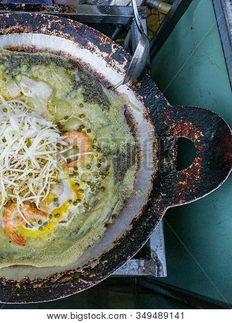 Vietnamese Sizzling Crepe With Shrimp And Bean Sprouts- Banh Xeo