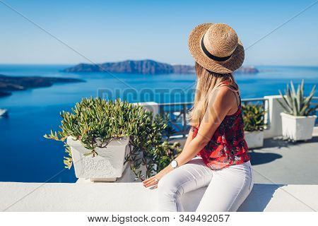 Woman Traveler Looking At Caldera Landscape From Thera, Santorini Island, Greece. Tourism, Traveling