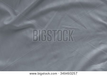 White Linen Bed Sheet Texture In Hotel Bedroom. Closeup Detail Of Messy White Bed Sheet. Comfortable