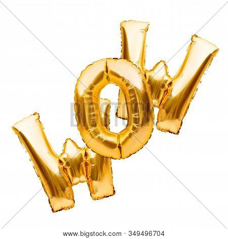 Golden Sign Wow Made Of Inflatable Balloon Isolated On White Background. Gold Foil Balloon Letters,