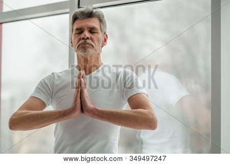 Enhance Your Mind With Meditation.senior Man Practicing Yoga.