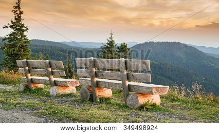 Benches On The Feldberg With A View Over Hazy Hills.