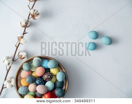 Colorful Easter Eggs In Basket On Bright Background. Easter Holiday Decorations , Easter Concept Bac