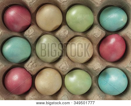 Colored Easter Eggs In A Package. Preparation For Holy Easter. Quail Egg.