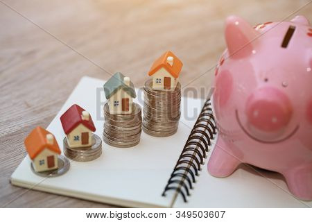 Mini House On Stack Of Coins, Concept Of Investment Property, Investment Risk And Uncertainty In The
