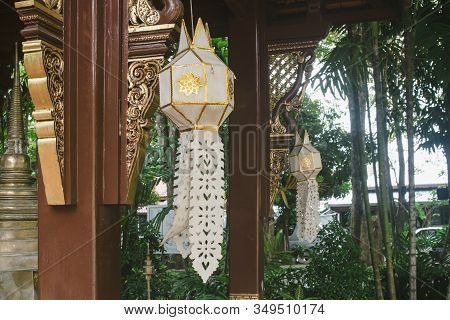 White Lanna Lanterns Hanging In Wat Phra Singh Temple During Day Light, After Lantern Festival Or Yi