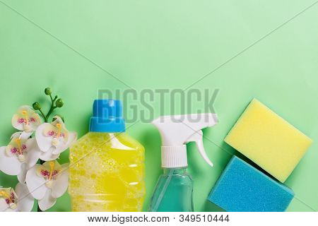 Cleaning Set For Spring Regular Clean Up On Green Background. Copy Space.