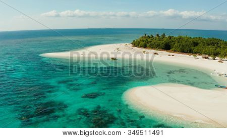 Aerial View Of Sandy Beach On A Tropical Island With Palm Trees By Coral Reef Atoll. Patawan Island