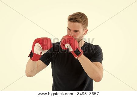 Full Concentration. Sportsman Concentrated Training Boxing Gloves. Athlete Concentrated Face With Sp