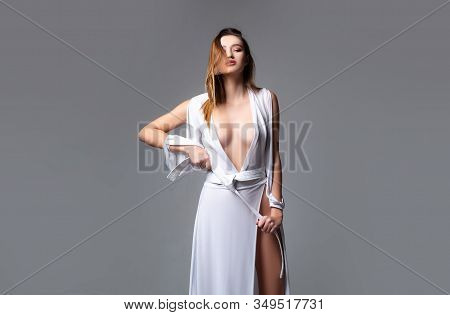 Sensual Model Girl In White Dress. Beautiful Young Woman With Perfect Skin And Long Hair. Sexy. Port