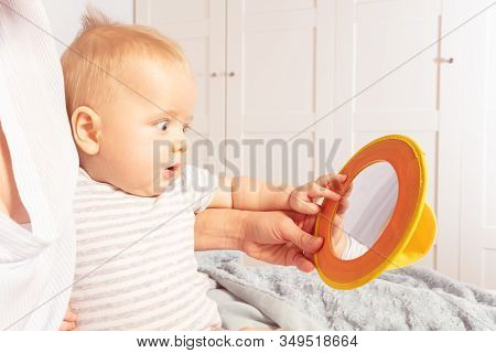 Baby Infant Boy Look At Mirror Together With Mom Sitting In Home Environment, Side View