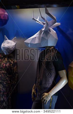 Mannequin Men In A Shop Window. Mannequin In A Paper Mask. White Deer Mask On A Man. Halloween Scene