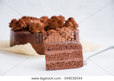 Chocolate Birthday Cake. A Slice Of Delicious Chocolate Cake. Piece Of Cake On A Table. Sweet Food.