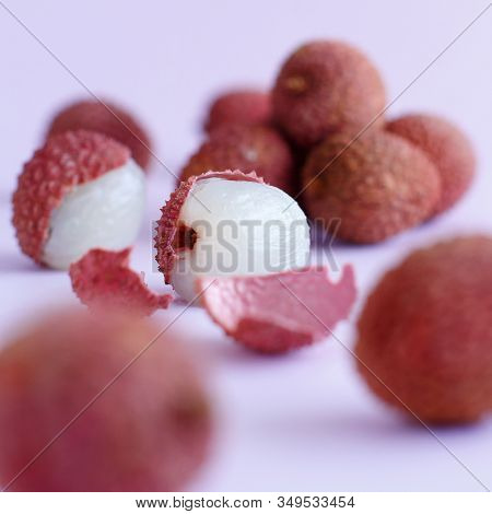Fresh Litchi Fruits On A Lavender Backgrpund  Close Up