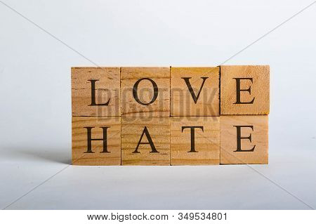 Wooden Cubes With Lettering Spelling Love Hate. Concept That Love Beats Hate