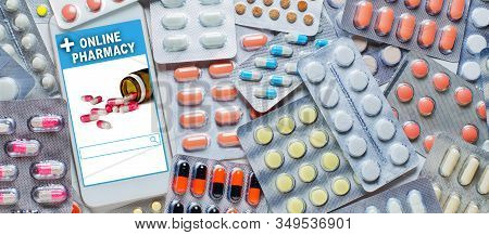 Online Pharmacy. Application In Smartphone For Online Ordering Of Medicines. Lots Of Pills. The Conc