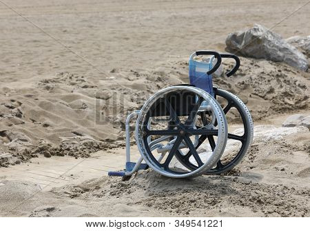 Problem With Special Wheelchair On The Sandy Beach