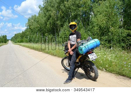 Russia, The City Of Murom. July 09, 2018. A Yellow Enduro Motorcycle With Things Is Standing On The