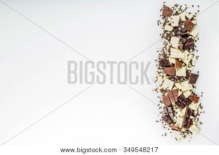 Assorted Different Types Of Chocolate. Broken Pieces Of Dark, Milk And White Chocolate, With Nuts, C